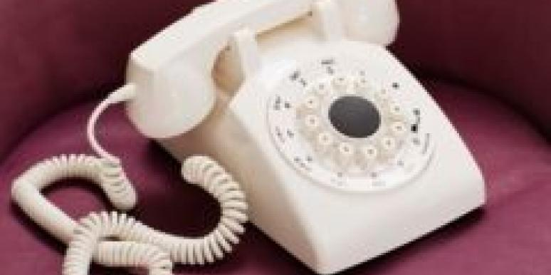 white telephone burgundy sofa