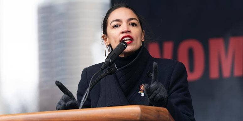 alexandria ocasio cortez speaking at podium