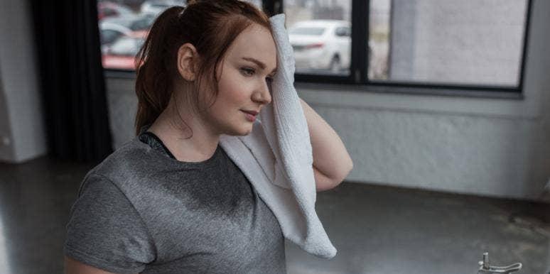 sweaty woman toweling herself off