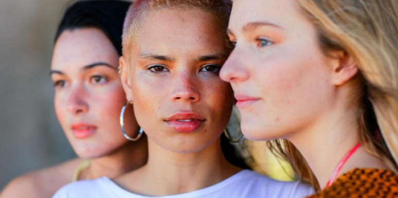 three women, two in profile, one looking ahead