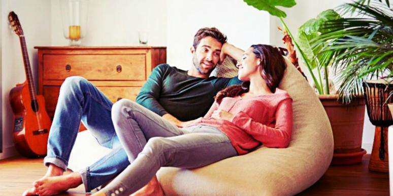 man woman on couch talking about divorce
