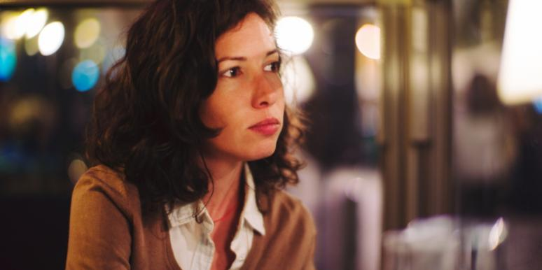woman with short brown hair looking into the distance