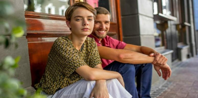 couple sitting on a stoop