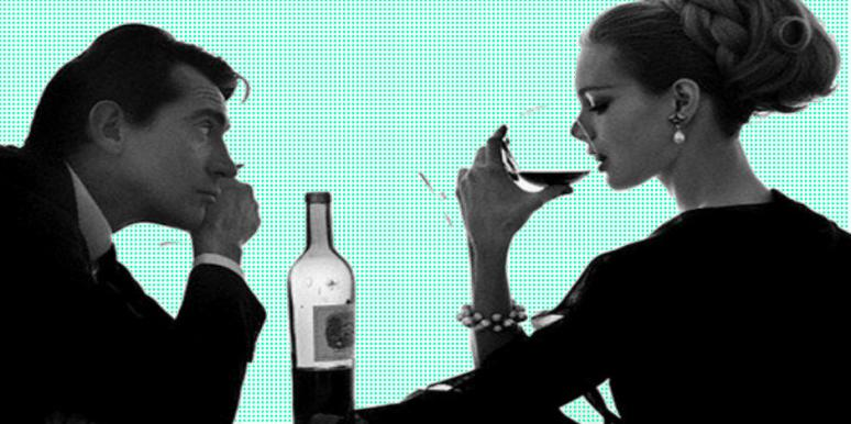 girl drinking wine with uninterested guy