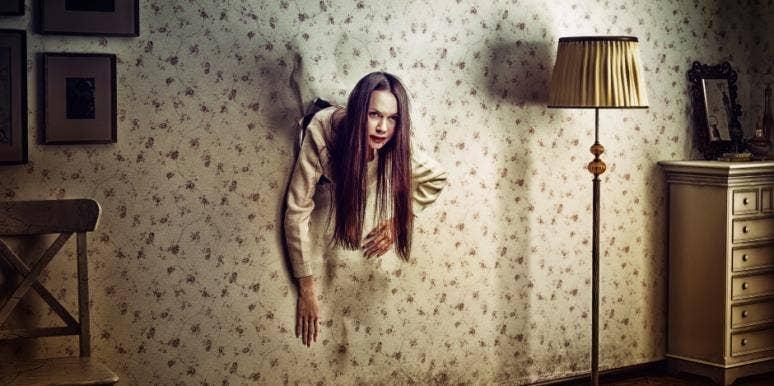 woman-coming-through-wall