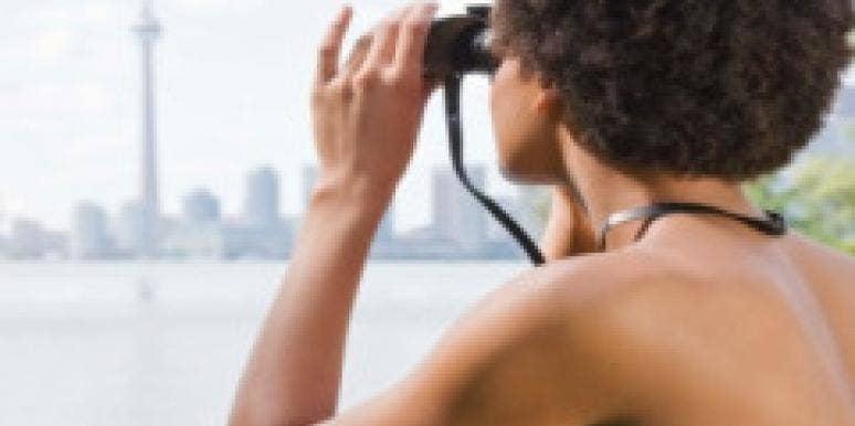 woman using binoculars
