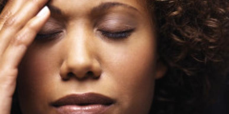 woman with headache stressed