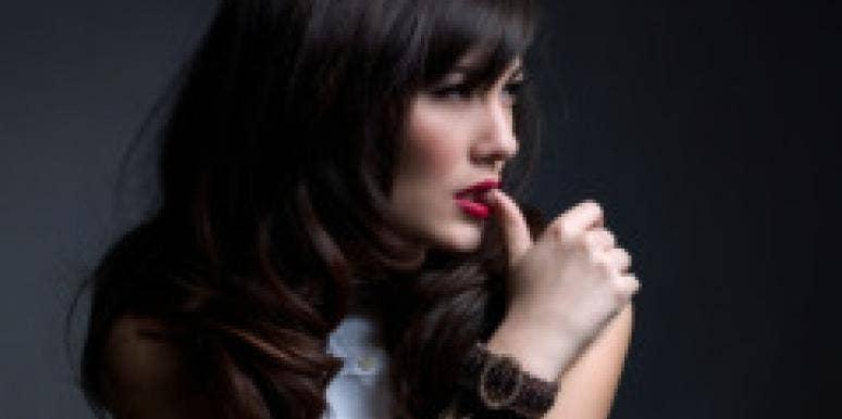 woman dark background