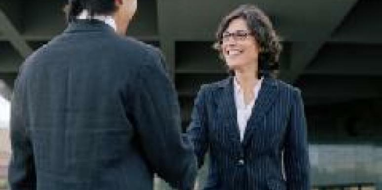 woman flirting in business suit