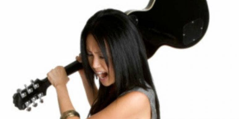 woman smashing guitar