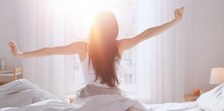 woman stretching morning waking up