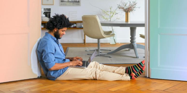 man sitting on the floor with laptop