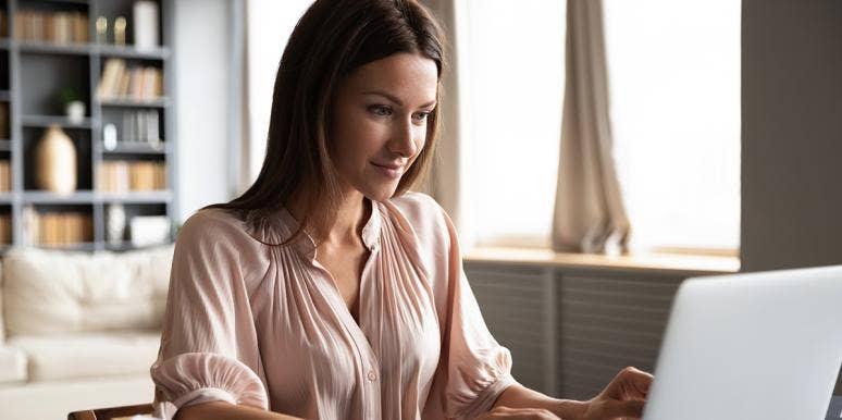 woman smiling looking at computer
