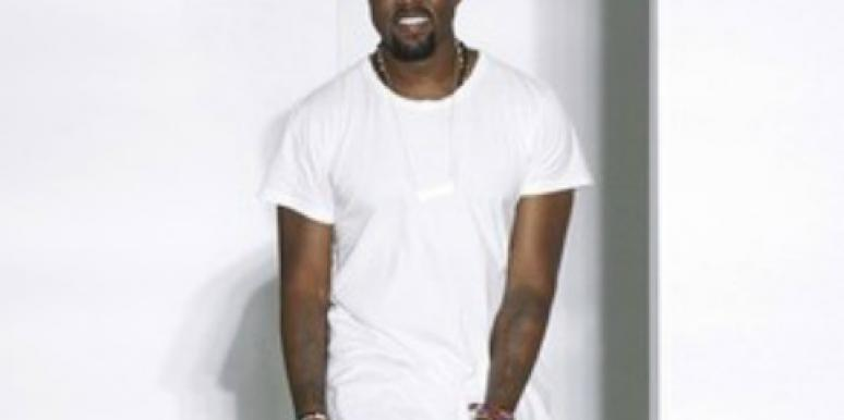 Kanye West at fashion week in white shirt