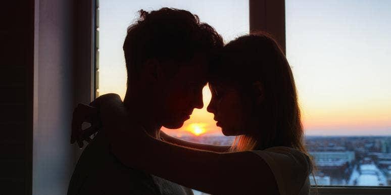 man and woman at sunset