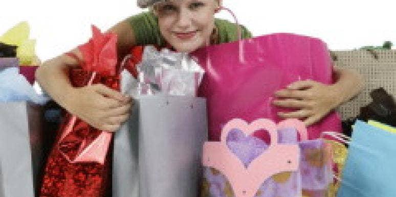 Happy shopper hugging bags