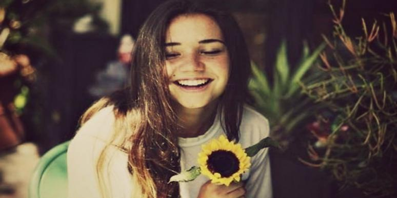 girl smiling with flower