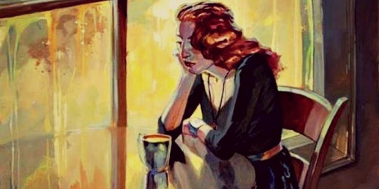 woman looking frustrated at cafe