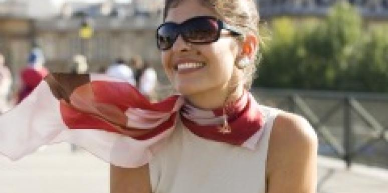 jackie kennedy Dark haired woman with sunglasses and scarf