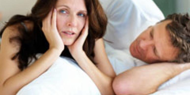 dissatisfied woman in bed with a man