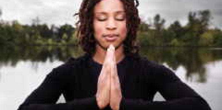woman praying meditation