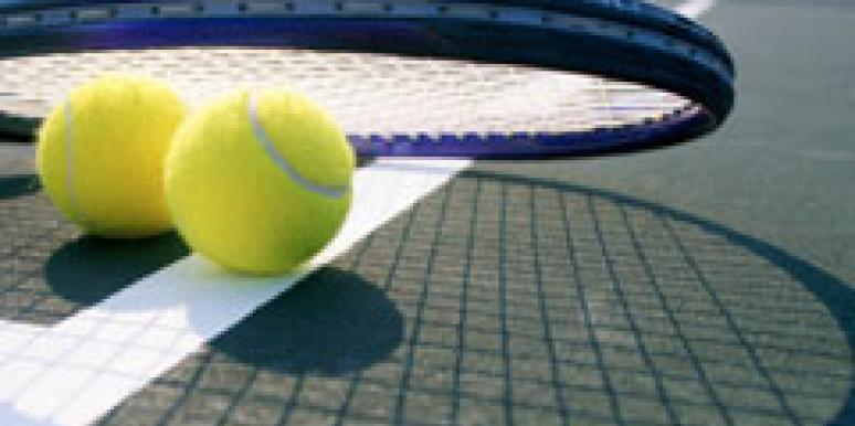 tennis balls and raquet