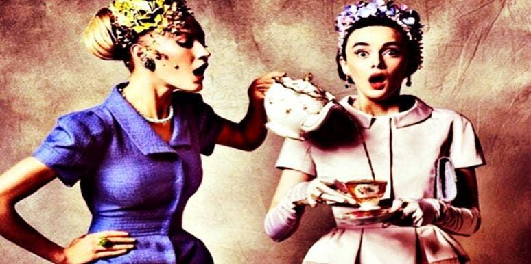 women dressed in vintage clothing holding tea