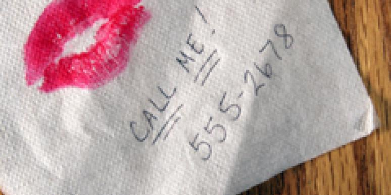 Lipstick and phone number on napkin