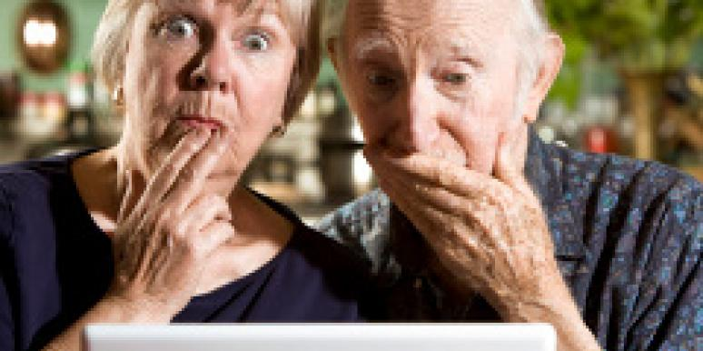 scandalized old people in front of computer