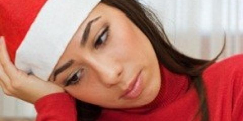 Sad woman in santa hat