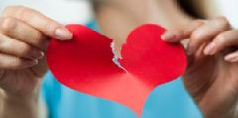 tearing up a paper heart
