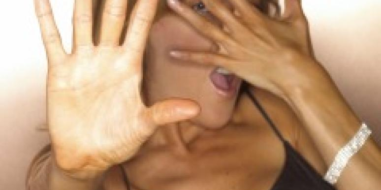Woman covering face with hand