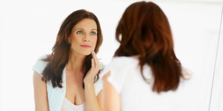 woman looking at herself