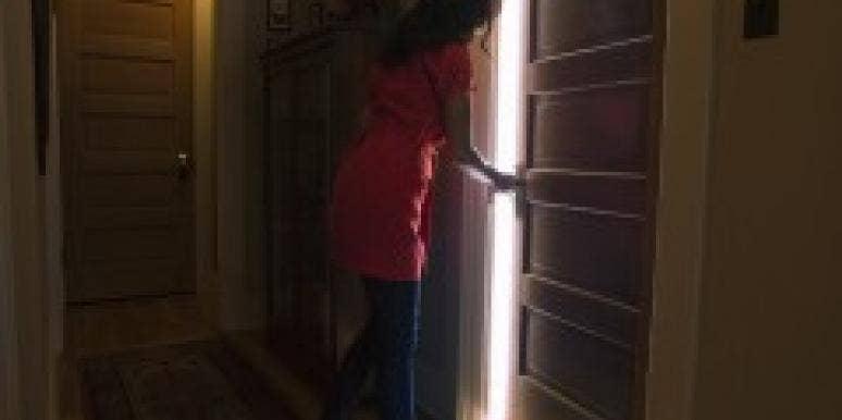Woman opening closed door