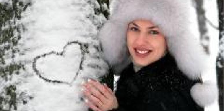 winter woman snow heart on tree