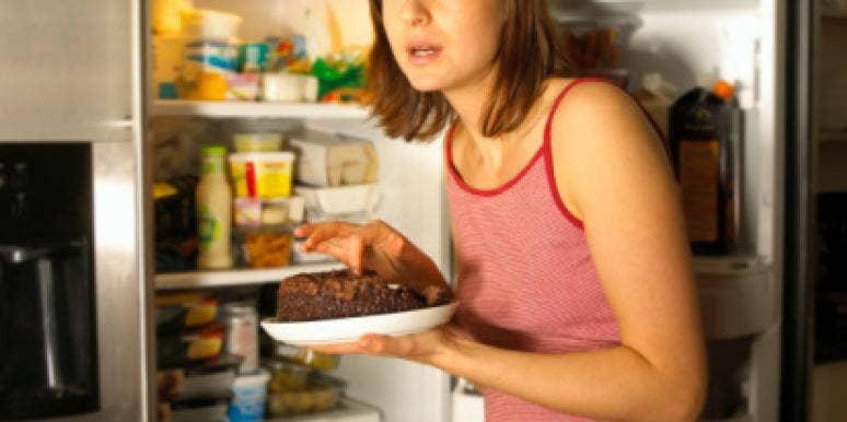 woman sneaking cake