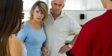 Angry parents in front of couple