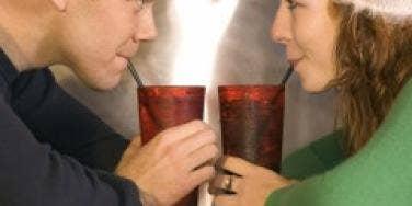 Couple drinking soda