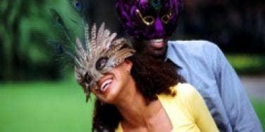 couple enjoying mardi gras celebration date