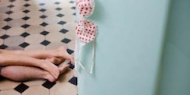 couple on kitchen floor having sex