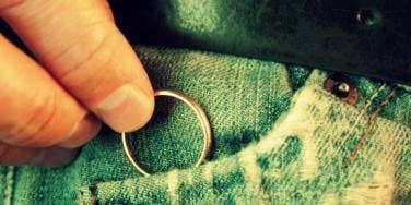 guy hiding wedding ring
