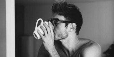 Sexy shirtless guy drinking cofee