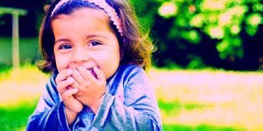 little girl giggling