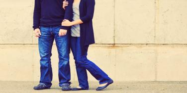 woman holding man's arm