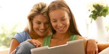 gay couple using laptop