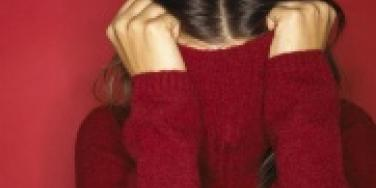woman hiding in turtleneck