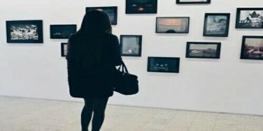 Woman looking at pictures.