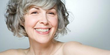 grey haired woman smiling