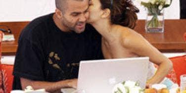 Eva Longoria whispering to Tony Parker