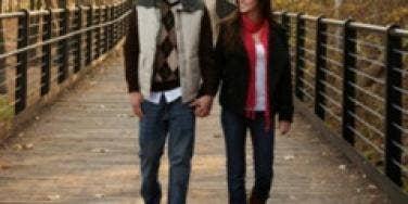 Man and woman walking on a bridge
